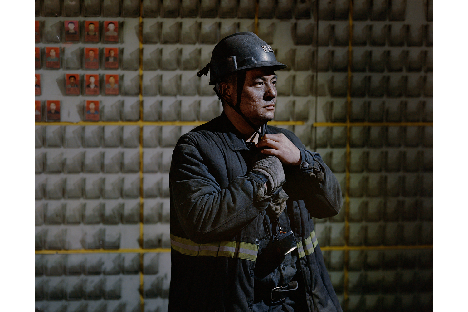 May 3, 31-year-old Yu Cunjiang takes off his safety helmet and gets ready for breakfast after working a 14-hour night shift in the Jinhuagong coal mine in Datong, Shanxi province. Shanxi, whose economy once relied heavily on its mineral resources, has shuttered 52 coal mines in the past two years in order to combat pollution, laying off thousands of workers in the process. (Li Junhui)