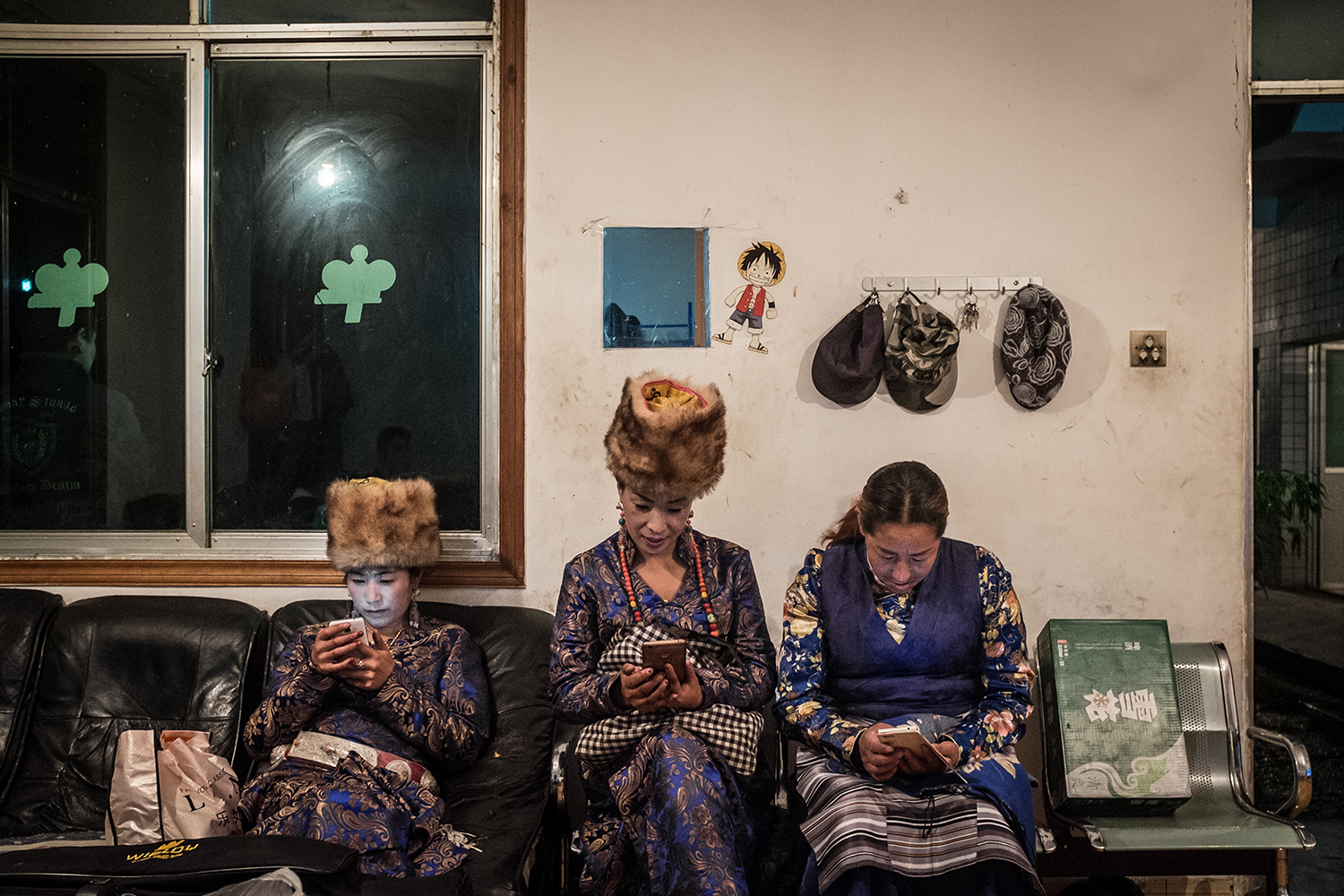 Tibetan women wait for a party hosted by Kun to celebrate the mining machines' upgrade, September 26, 2016.