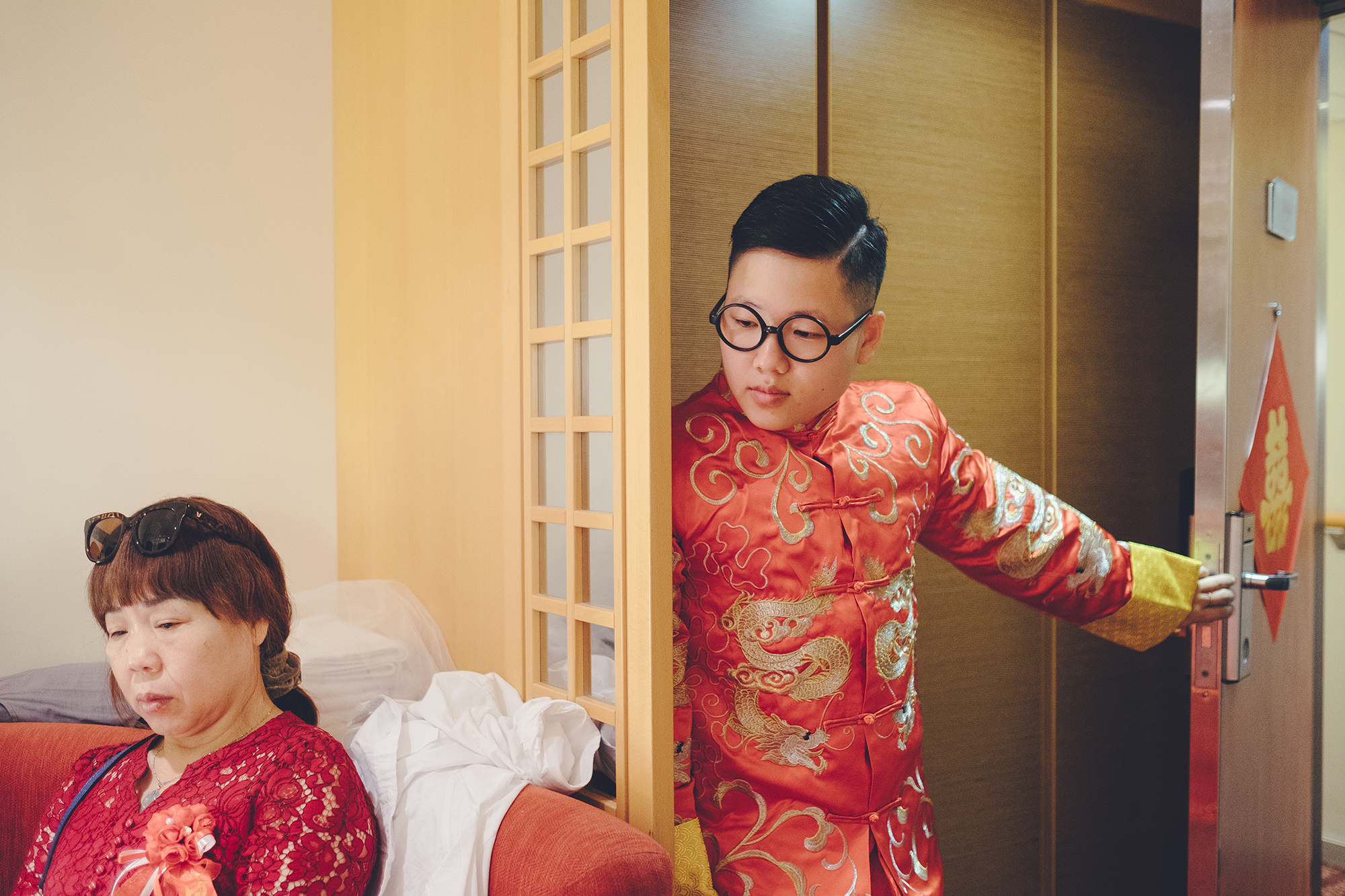 "Chen and his mother wait for Yang to get dressed before the wedding. Mrs. Zheng has been apprehensive about Chen and Yang's relationship. She is not comfortable with her ""daughter"" being transgender, but she wants him to be happy."
