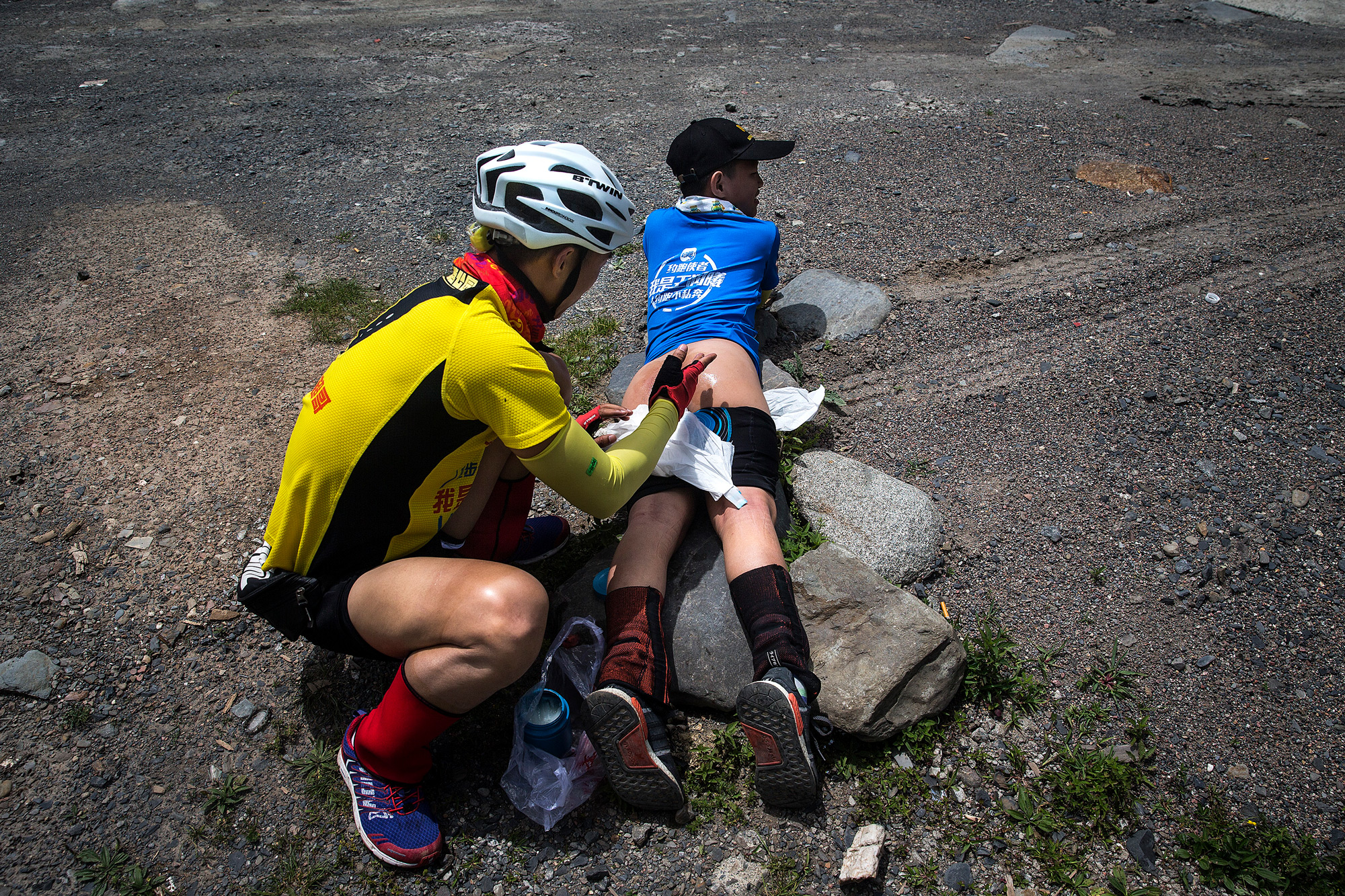 The father and son have pledged to bike the entire route, without riding in any automobiles. So, bearing the pain, Runxi keeps going with his father. Chao applies Vaseline to Runxi's irritated skin before they depart for the sixth day's ride, which lasts for nine hours and 50 miles, July 20.
