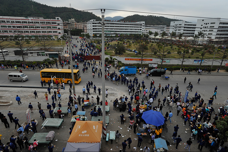A little after 7 a.m., some of the 18,000 employees arrive for work at the Taiwan-owned Freetrend plant in Longgang. It is the largest manufacturer of New Balance products in the world.
