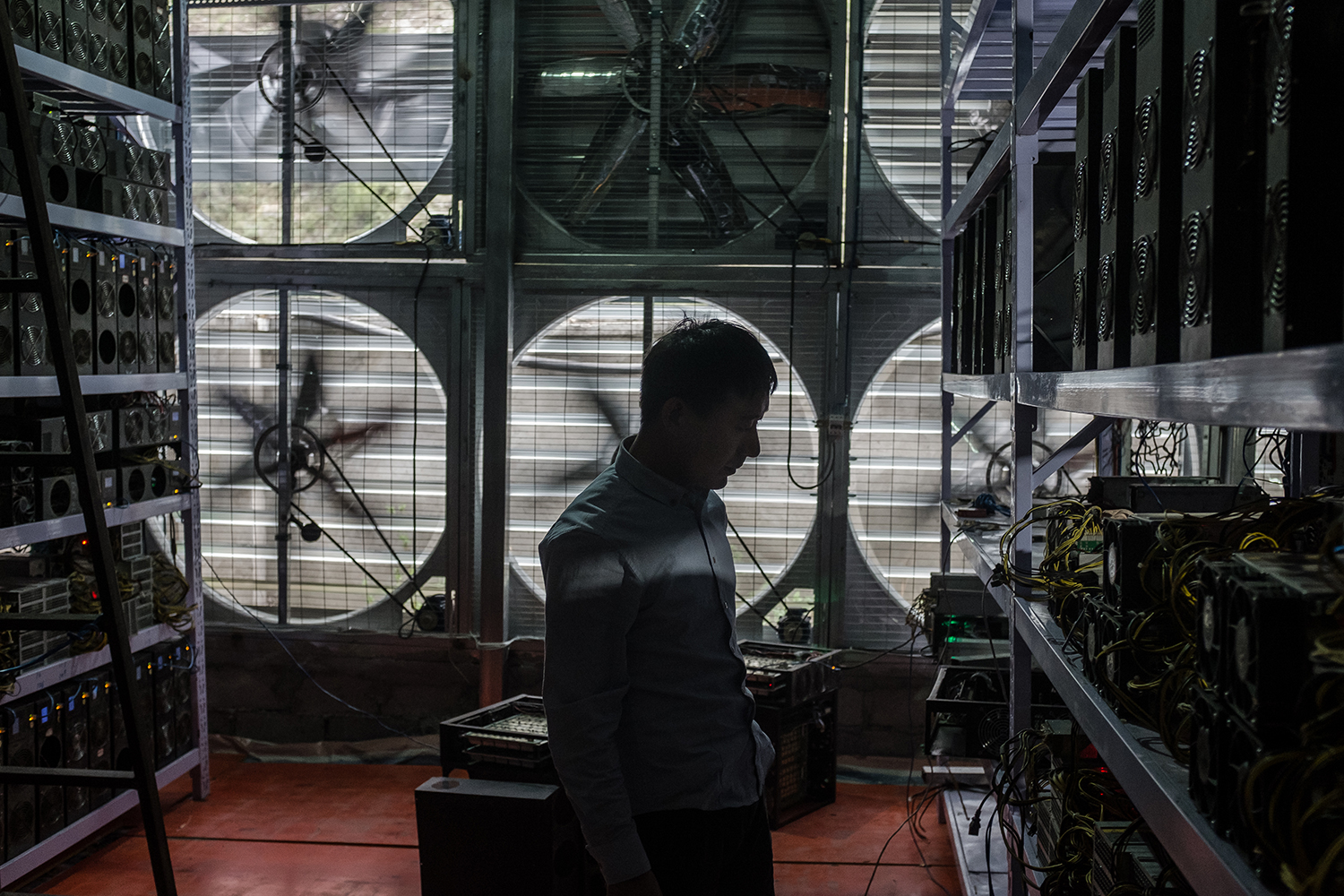 Liu, 29, stands in front of a wall of cooling fans at his Bitcoin mine where he houses and operates mining machines for miners who don't want to move to rural Sichuan, in Ngawa Tibetan and Qiang Autonomous Prefecture, Sichuan province, September 27, 2016.