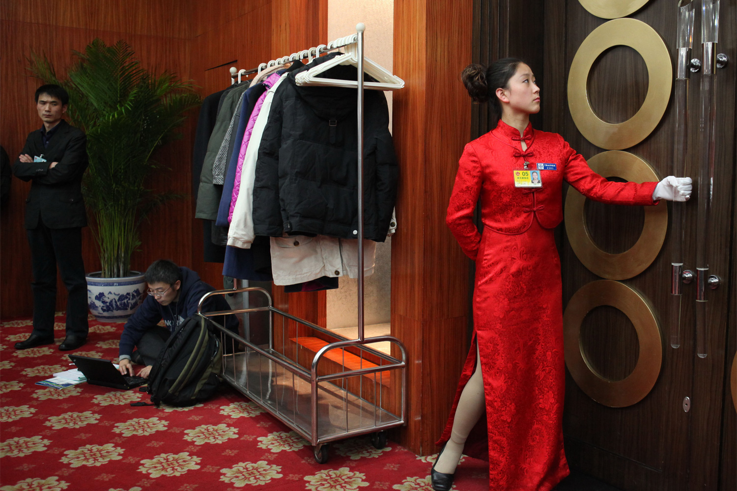A waitress prepares to open the door for others to pass through at the Capital Hotel, March 4, 2011.