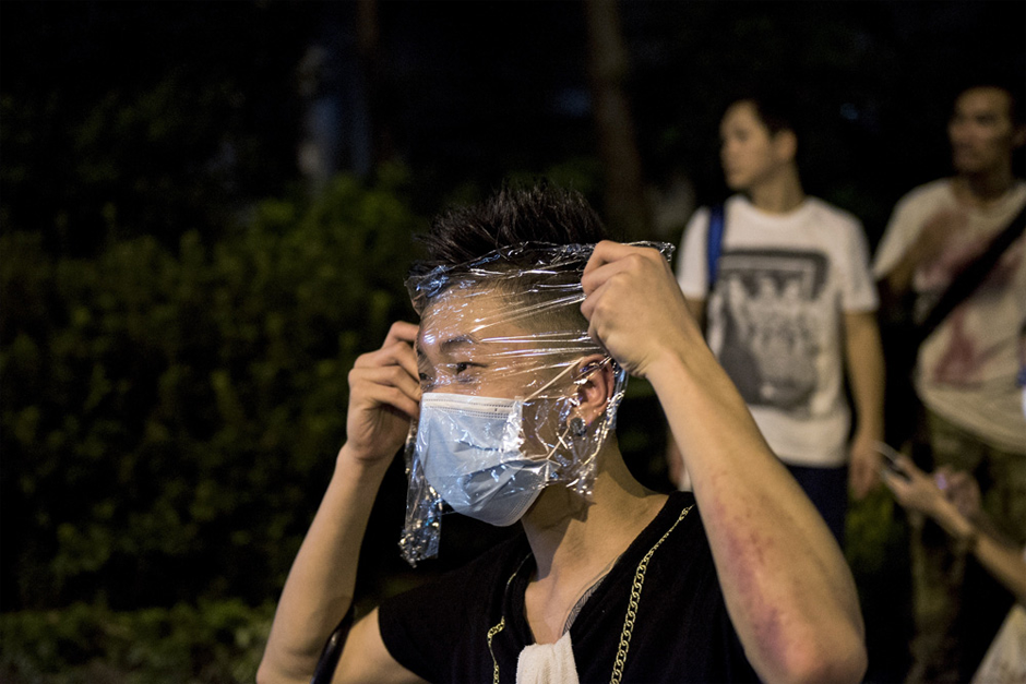 A pro-democracy protester wraps his face with plastic to protect himself against tear gas. (Photo by Alex Ogle/AFP/Getty Images)