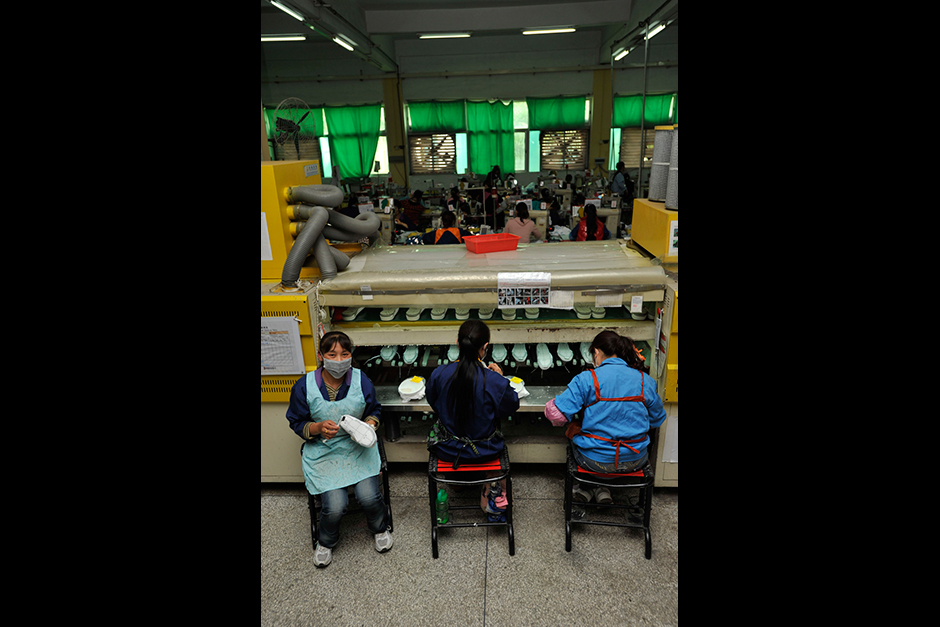 Xu Huali, 37, left rural Chongqing in 1991 with a grade school education, eventually moving to Wuwucun in 1999 after getting married with another Chongqing migrant. She has been making shoes for more than a decade, and currently glues soles to uppers for New Balance for 2000 yuan ($320) per month.