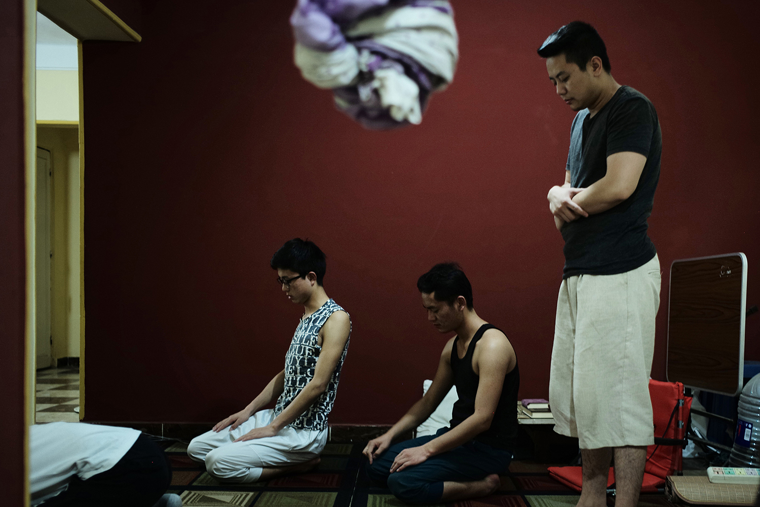 May 16, 19-year-old Eid (right), a member of the Muslim Hui minority, prays with his classmates, who are also Chinese Muslims, at an apartment they rent together in Cairo, Egypt. Eid studies at Al-Azhar University in a program that prepares students for college. He rarely returns to China because he worries he might not be allowed to leave the country again. This year, China launched a campaign to repatriate and interrogate Muslims studying overseas. (Li)