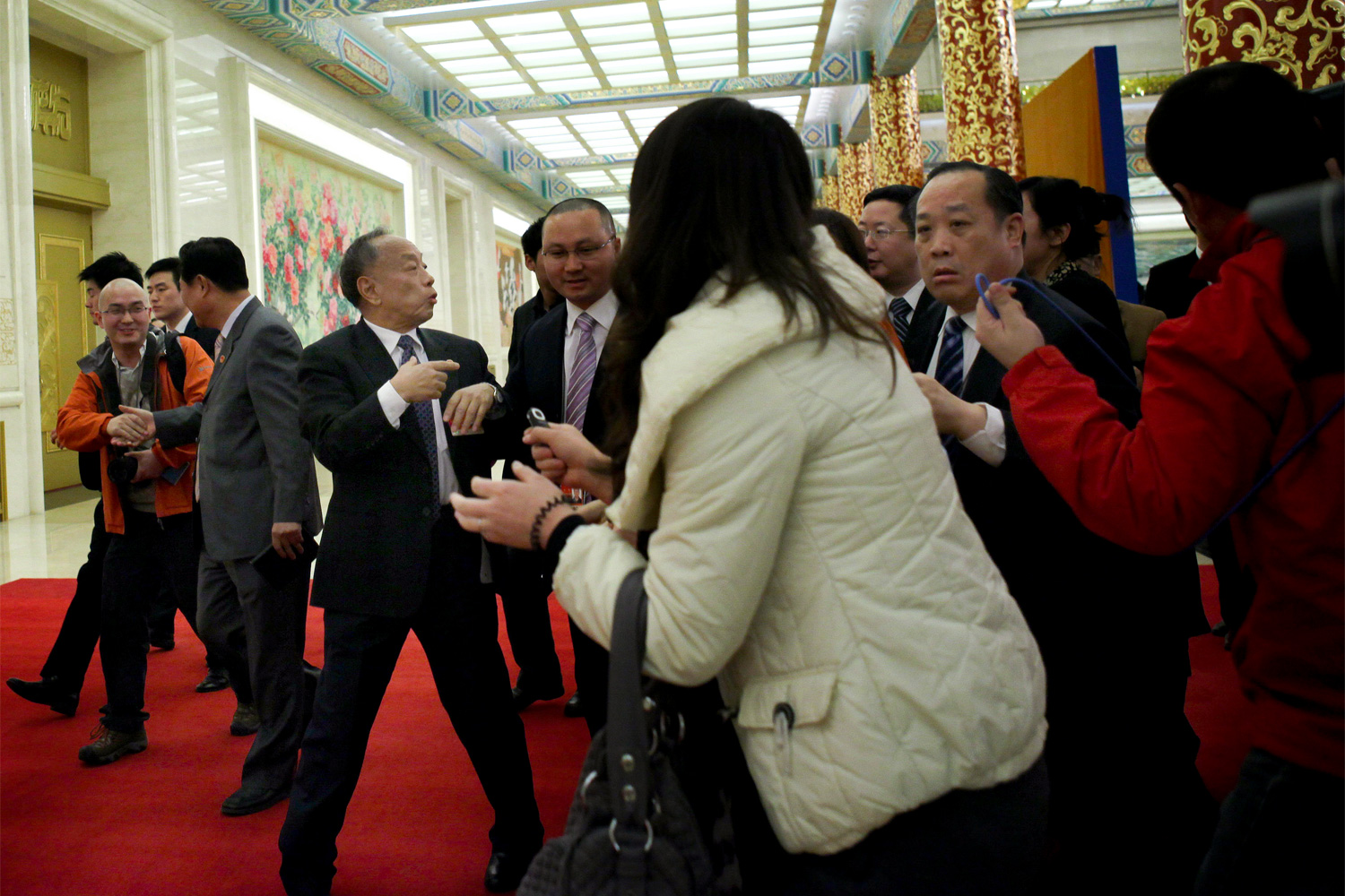 Li Zhaoxing, a spokesperson for the NPC, turns to answer questions from journalists after a press conference, March 4, 2011.