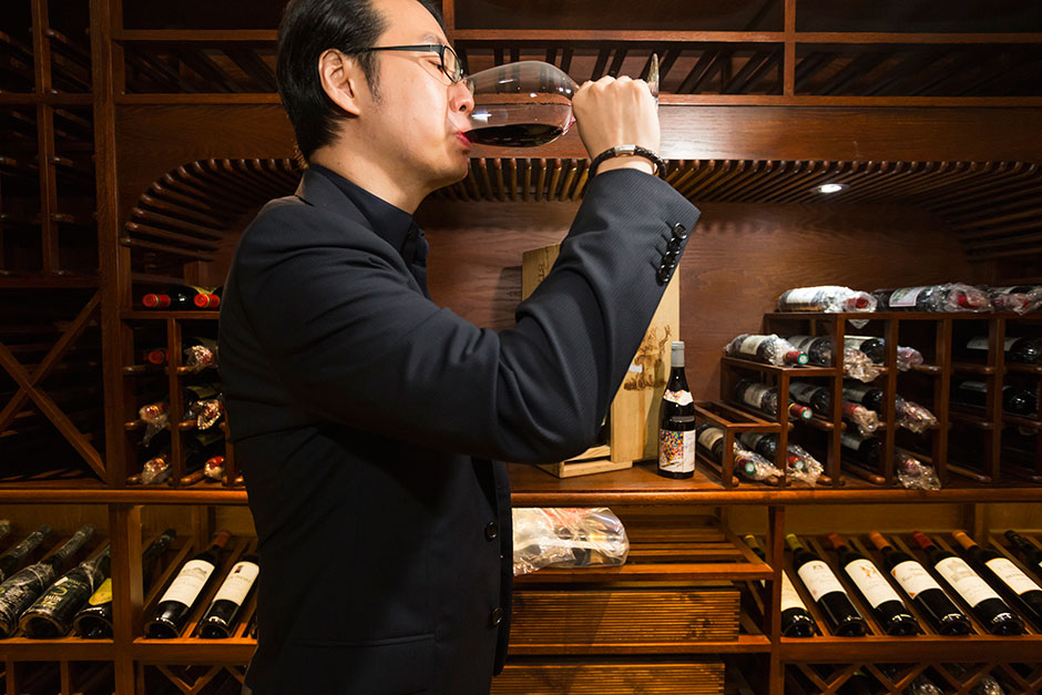 "Architect Jeffrey Zee, a member and designer of A.S.C. Fine Wines' ""Wine Residence"" in Shanghai, drinks red wine in his private cellar."