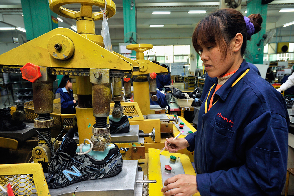 Zhao Meifang's sister-in-law, Xu Xiaoying, works the factory line at the Freetrend New Balance plant.