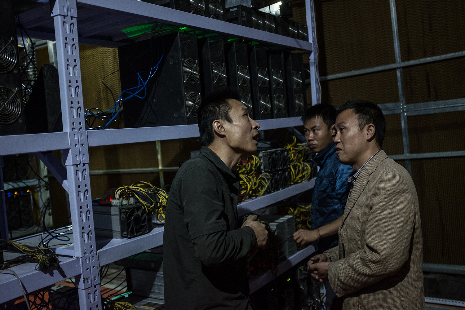 Liu meets with clients, September 27, 2016. He moved from Henan province to Sichuan province in 2015 for the cheaper electricity. Now, he manages more than 7,000 mining machines for clients all over the country. Meanwhile, his clients can monitor the machines' operation and Bitcoin earnings remotely using apps on their mobile phones.