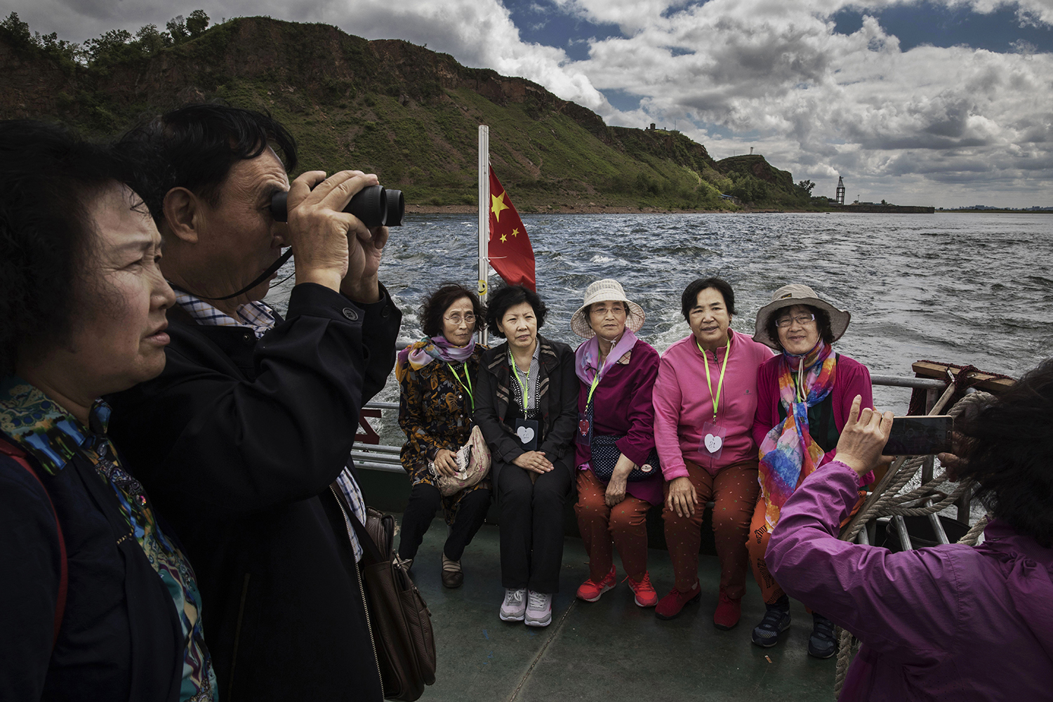 May 23, Chinese tourists ride in a boat on the Yalu river, which forms part of the border between China and North Korea. China has long been North Korea's most important ally and trading partner, but relations are increasingly strained by continued missile testing and provocations by the regime of Kim Jong-un. (Kevin Frayer/Getty Images)