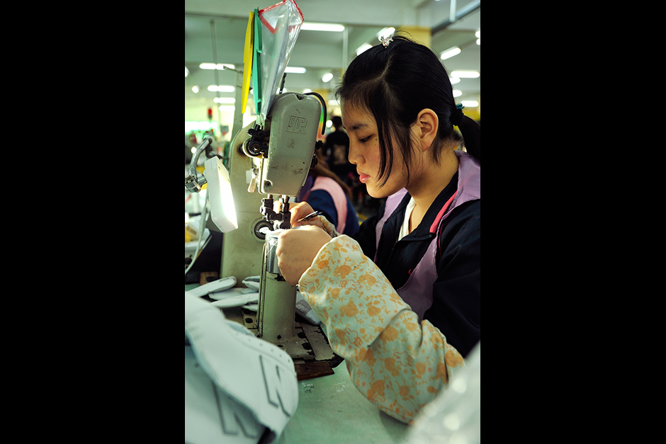 Wang Qiong started working on the New Balance line two years ago. Stitching uppers, she earns about 1,800 yuan ($290) a month and saves nearly half. Previously, she worked at an electronics factory but feels that the sneaker line better develops her marketable skills.