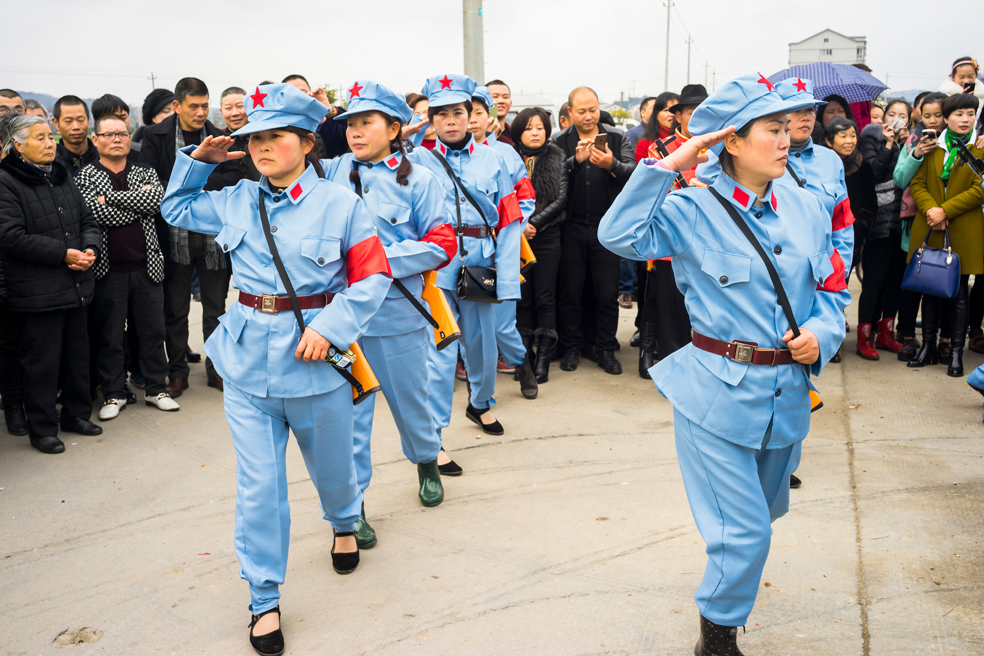 Women wearing replicas of Red Army uniforms perform at a Buddhist ceremony in Taoshan township, February 27, 2015. In order to gain government approval for the ceremony, the organizer added political propaganda elements to the event proposal.