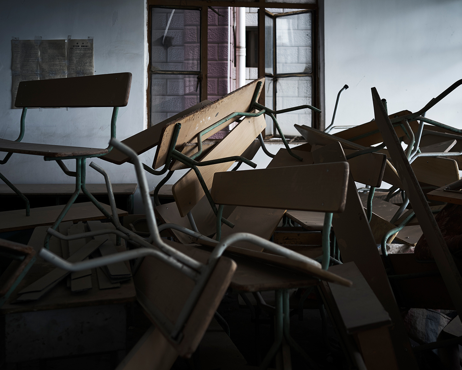 A pile of abandoned chairs and desks in Nanguan Mosque, June 2016. Since the expulsion of Muslims from outside of Yunnan in 2014, the number of students has declined significantly. Many classrooms have remained empty.