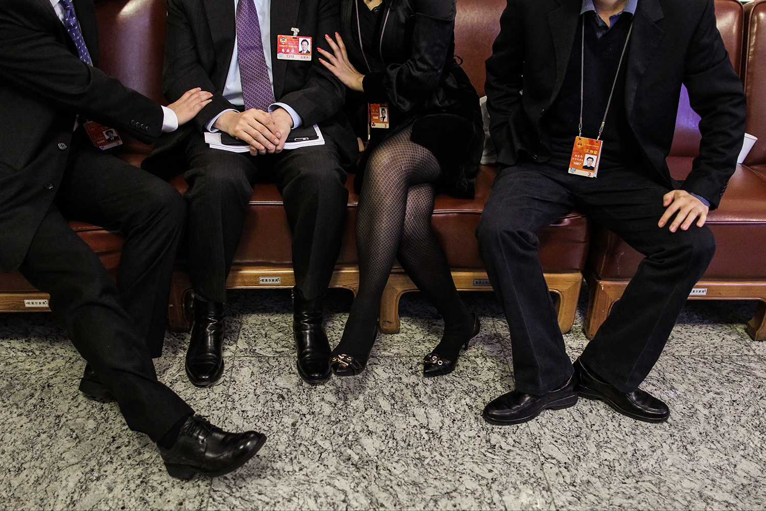 During a break between meetings, a female staffer talks with a member of the CPPCC, second from left, and two male staffers, March 5, 2011, on the second floor of the Great Hall of the People.