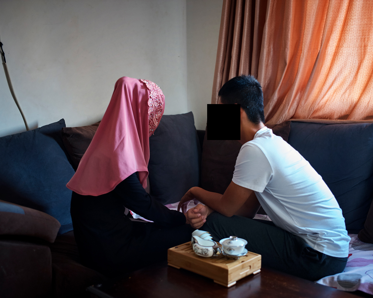 Umar and his wife Sofia in their rented apartment near the University of Jordan, in Amman, September 2017. Sofia is Hui and was born in the Xinjiang Uighur Autonomous Region. She moved to Amman to join Umar after they married in the summer of 2017. She didn't let anyone but her parents know about her whereabouts out of fear of being reported to the local authorities in Xinjiang. She told people she was doing business in Guangzhou.