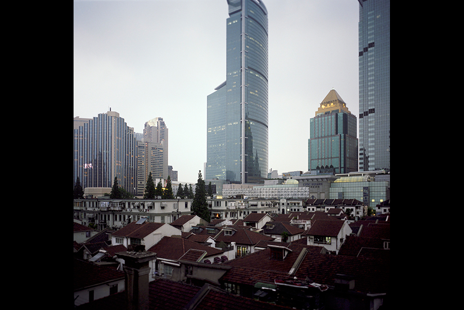 A traditional Shanghai <em>longtang</em> (alleyway) neighborhood along Weihai Road was granted historic landmark status and is protected even as development continues all around it.