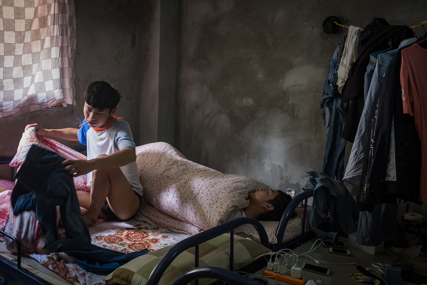 "Sun's colleagues rest in their dorm, September 28, 2016. They live at the mine, which is so remote the nearest public transportation is 20 miles away, in the nearest town. They pay to hitchhike there once a week. ""The good thing is, there isn't anywhere to  spend money, so you can save your whole salary,"" Sun says."