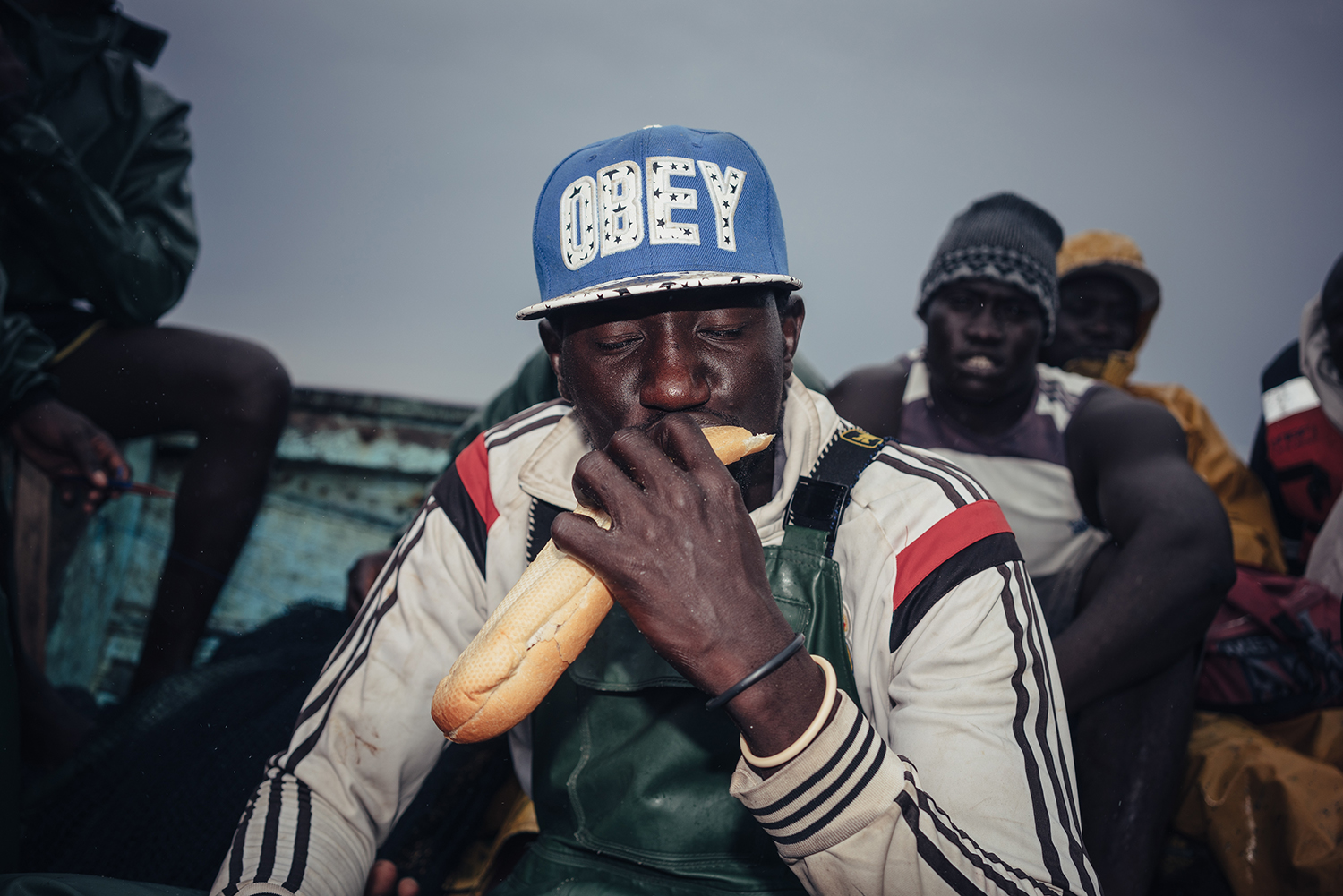 Youssou Diouf, 38, captain of a local fishing ship from Joal-Fadiouth, Senegal, eats a baguette during a break, July 15, 2016. The fishermen's diet while at sea consists almost exclusively of bread and roasted fish.