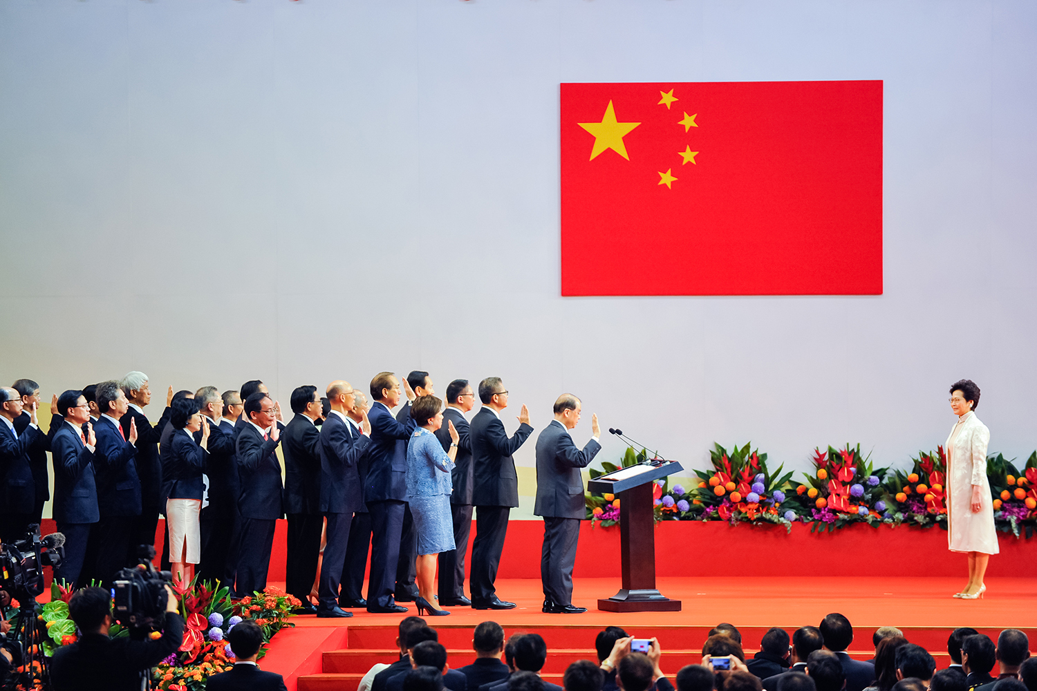 July 1, Carrie Lam Cheng Yuet-ngor (right), Hong Kong's new Chief Executive, and her new cabinet are sworn in by Chinese President Xi Jinping during an inauguration ceremony in Hong Kong. (Keith Tsuji/Getty Images)