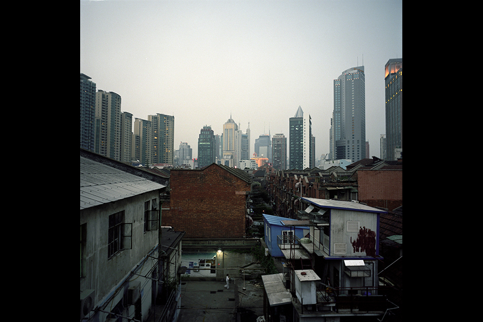 The 696 Art Factory neighborhood, located in the center of Shanghai, is one of the newest clusters of galleries and artists' live-in studios. They were informally converted from what was once a bankrupt automobile-parts factory. While it takes a long time for such developments to change into residential or high-density commercial use sites, having art-related businesses move onto the run-down former industrial land is often seen as economically favorable. This can lift the commercial value of the land. Eventually, the pioneering artists and galleries will be priced out of the market, which is what has also happened in Shanghai's Moganshan and Beijing's 798 districts.