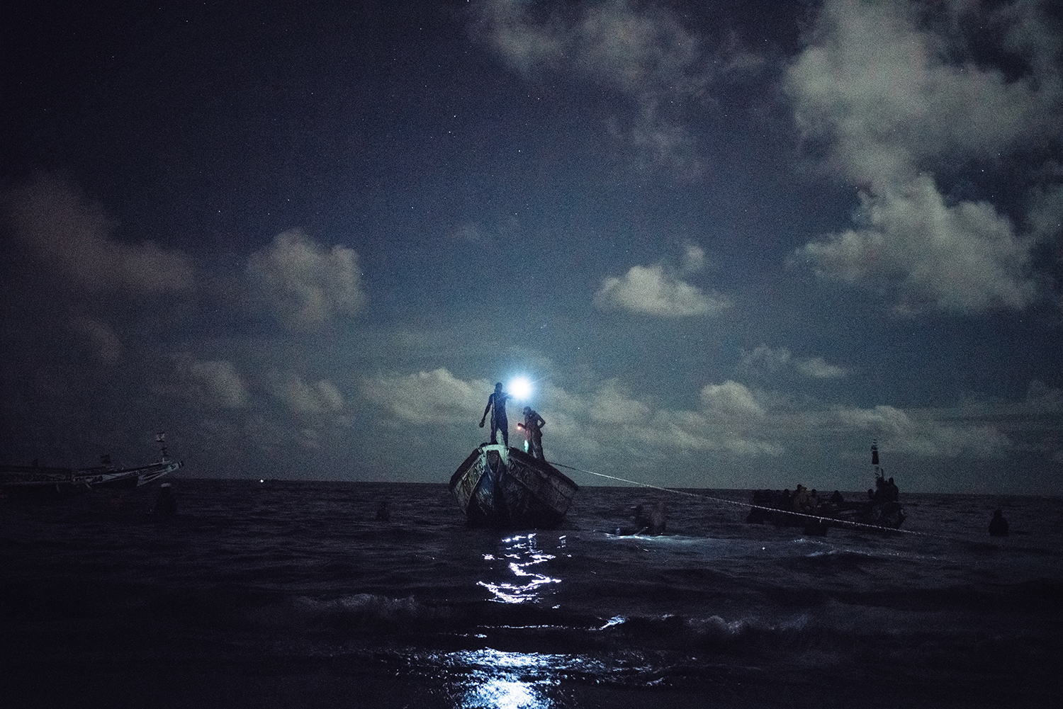 Just after midnight, Diouf and his crew finish a day's work at sea and have come in to shore in Joal-Fadiouth, Senegal, southeast of Dakar, July 15, 2016. According to Diouf, they used to be able to fish from the shore, but in recent years, they have to venture farther out to sea, sometimes as much as 25 miles, to find enough fish.