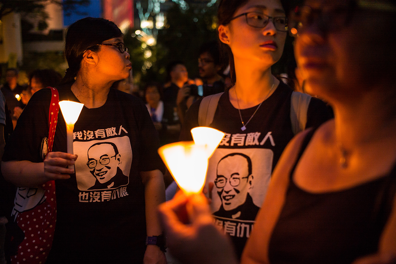 "July 15, protesters carrying candles take part in a march to mourn the death of Nobel laureate Liu Xiaobo in Hong Kong. Liu, a literary theorist, poet, and longtime dissident who authored the pro-democracy manifesto ""Charter 08,"" died on July 13 from complications of liver cancer while serving an 11-year prison sentence for ""incitement to subvert state power."" He was 61. (Billy H.C. Kwok/Getty Images)"