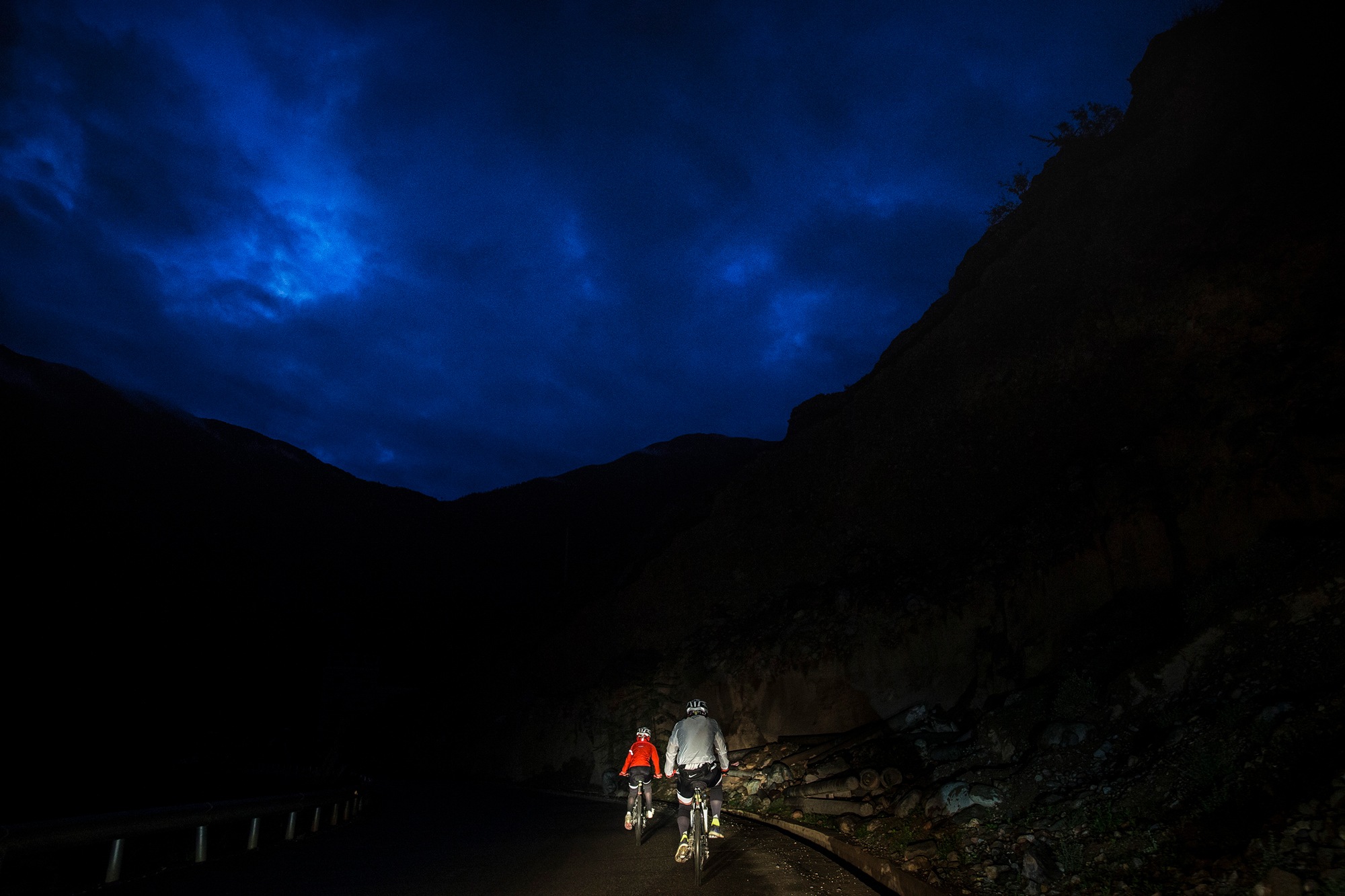 In order to cross a bridge which will be closed later in the day, Chao and Runxi get up at 5:00 a.m. to start the day's ride, in Rumei township, Qamdo, Tibet, July 26.