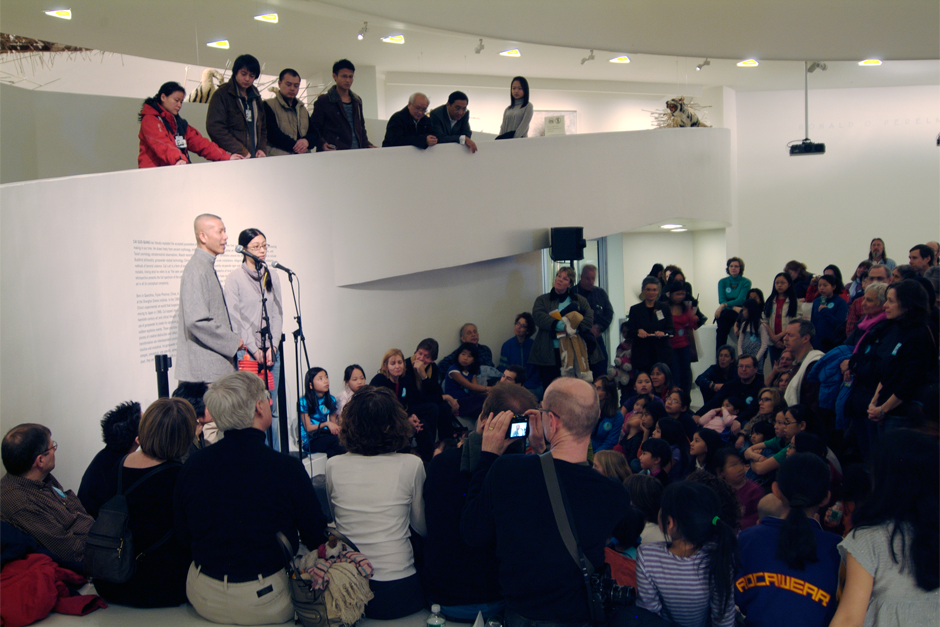 "Cai Guo-Qiang introduces his extended family from Quanzhou at a public event at the Solomon R. Guggenheim Museum, February 24, 2008. In conjunction with his exhibit, ""Cai Guo-Qiang: I Want to Believe,"" and in celebration of the Chinese Lantern Festival, the artist offered a special tour of the exhibit for Chinese-born adoptees and their American families. (Photo by Cheng-Shu Li, courtesy Cai Studio)"