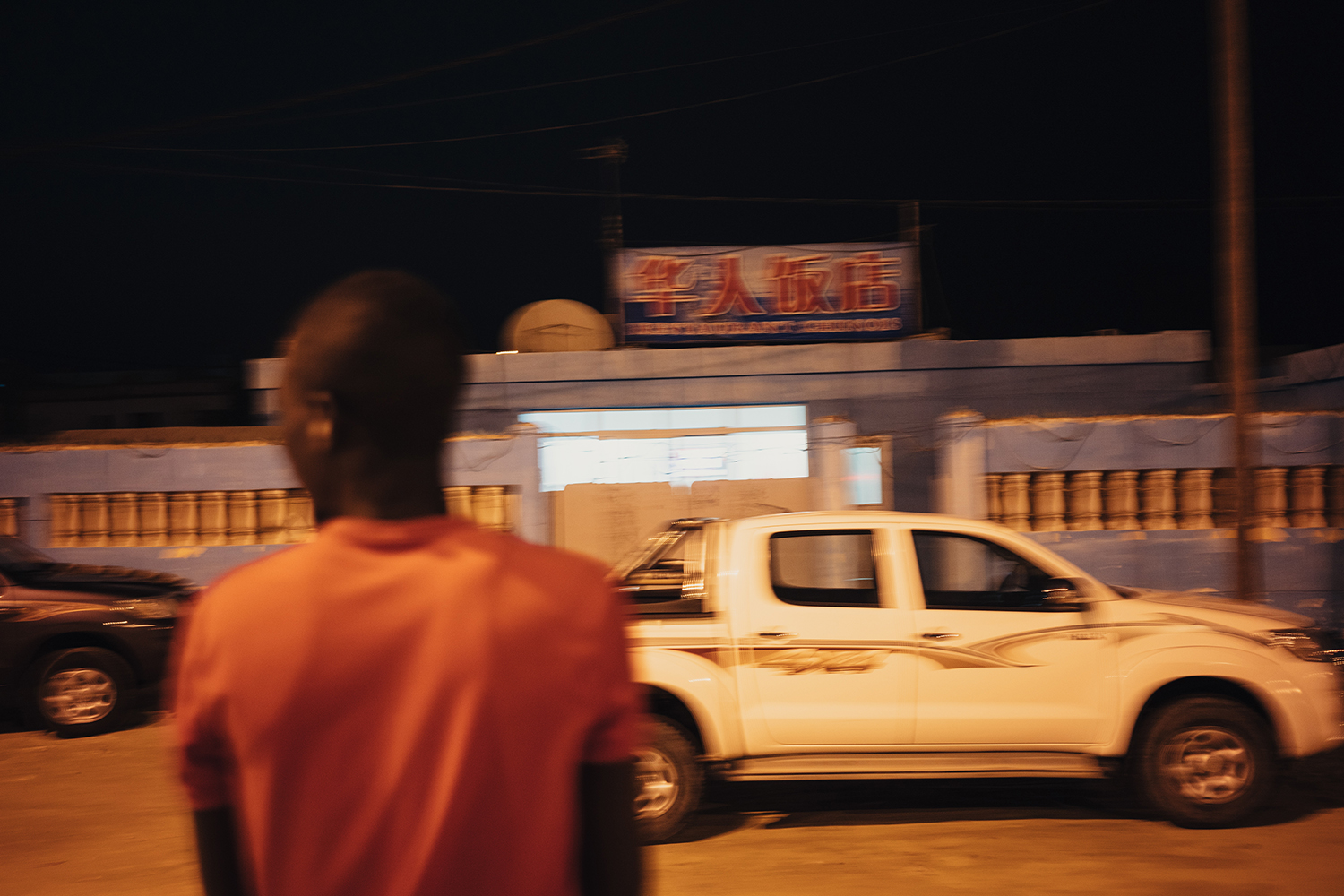 Employees of the China National Fisheries Corporation (CNFC) arrive in their cars at a Chinese restaurant in Nouadhibou, Mauritania, June 23, 2016. CNFC is one of the leading companies of China's distant-water fishing industry. In 1985, CNFC came to West Africa to enter the distant-water fishing industry and currently has business in Senegal, Mauritania, Guinea, and Guinea-Bissau, as well as elsewhere across the Pacific, Atlantic, and Indian Oceans.
