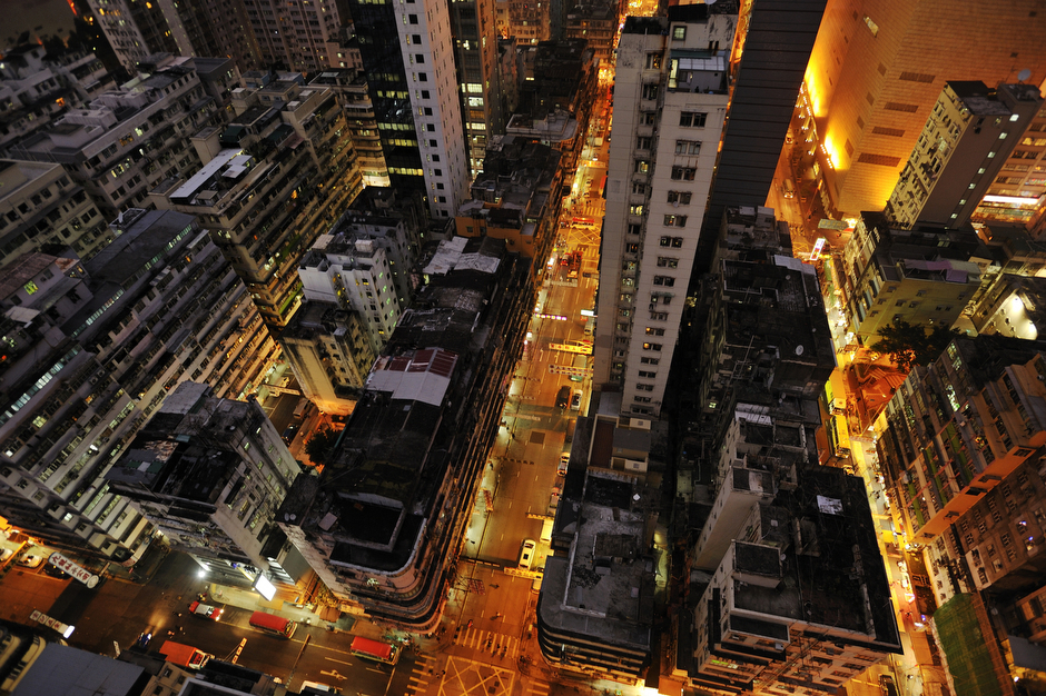 High above street level, a bird's-eye view of Mongkok district belies order and stillness, though the Guinness World Records has labeled this district as the world's busiest.