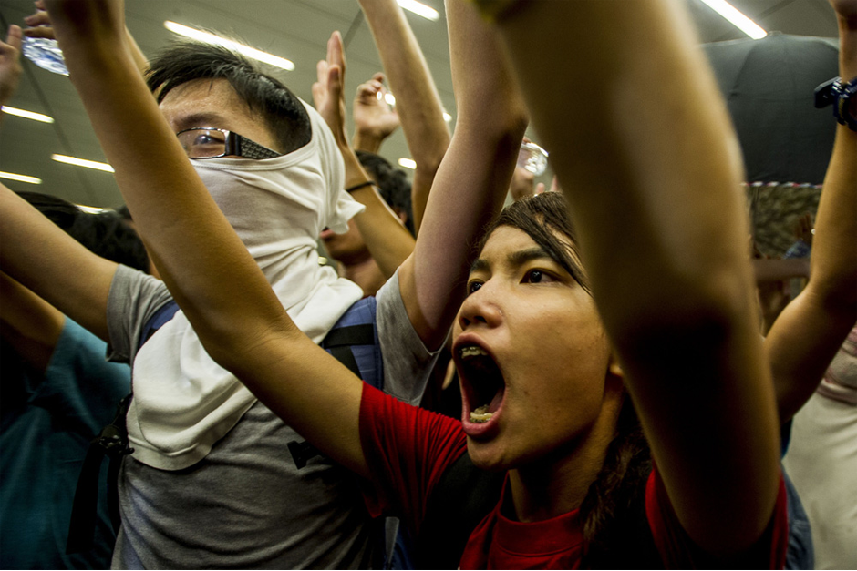 Pro-democracy protesters shout slogans during a demonstration at Hong Kong government headquarters. (Photo by Xaume Olleros/AFP/Getty Images)