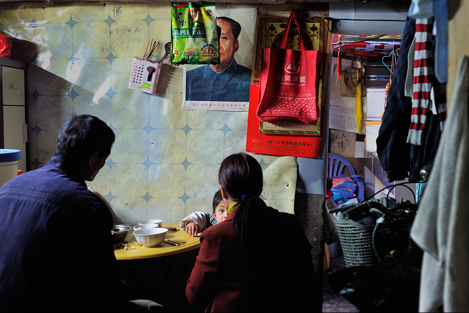 A family eats in their twenty-five-square-meter home.