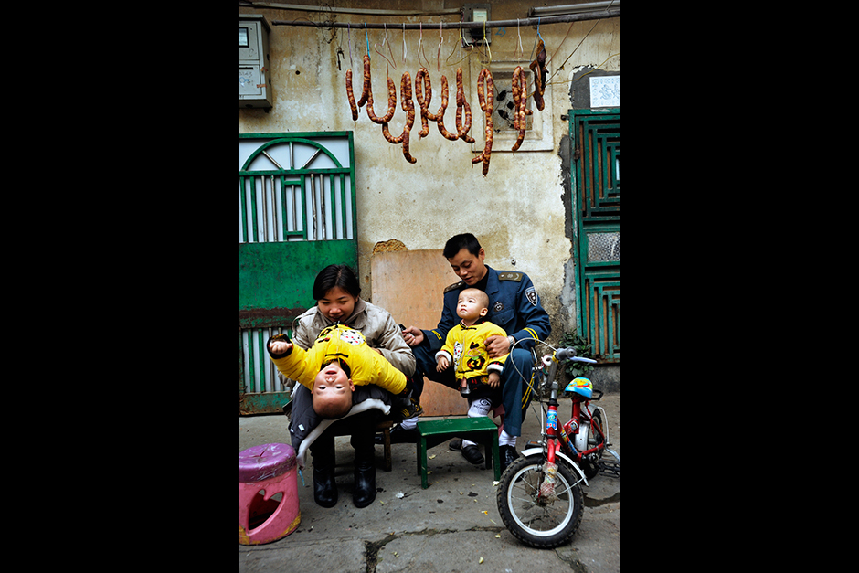 A couple who upgraded to a nearby apartment after having twins return to Wuwucun for a visit. The village homes are tiny—about 270 square feet—and typically house four people. Rent is 150 yuan ($24) a month, about half that of an apartment. Villagers who talk of going back to Chongqing say that it's mainly because education and housing are pricey in Shenzhen.