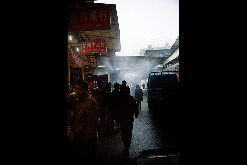The Tongchuan Road Wholesale Fruit Market in Shanghai's Putuo District is busy with activity during an evening in January 2010. The land of the market is collectively owned by the former farmers of the village that previously occupied the site.