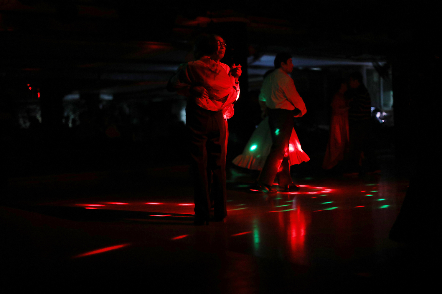 October 22, a man in his 70s dances at a club for middle-aged and elderly people in Hangzhou, Zhejiang province. China's One Child Policy has left the country with an aging crisis—almost a quarter of the country will be over 65 by 2050—and new businesses targeting elderly customers are beginning to emerge. (Liu Feiyue)