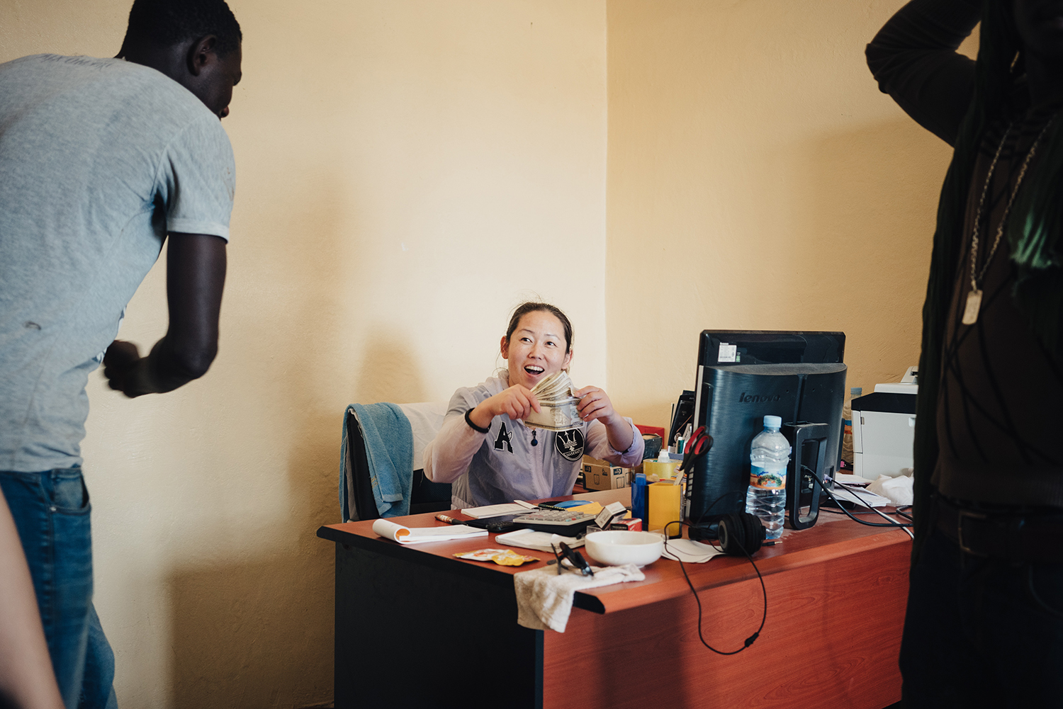 With the end of Ramadan approaching, Mrs. Zhang, a finance employee and cook at Lem Seafood, hands out workers' wages early, June 29, 2016. Local workers are paid around 50,000 Mauritanian Ouguiyas (U.S.$139) every month, which workers say is a good salary.