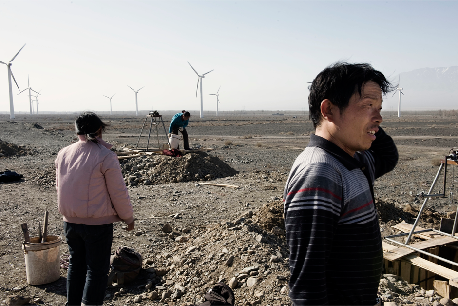 Migrant Han workers from Henan dig holes near a wind farm along National Highway 312 between Urumqi and Turpan, 2010.
