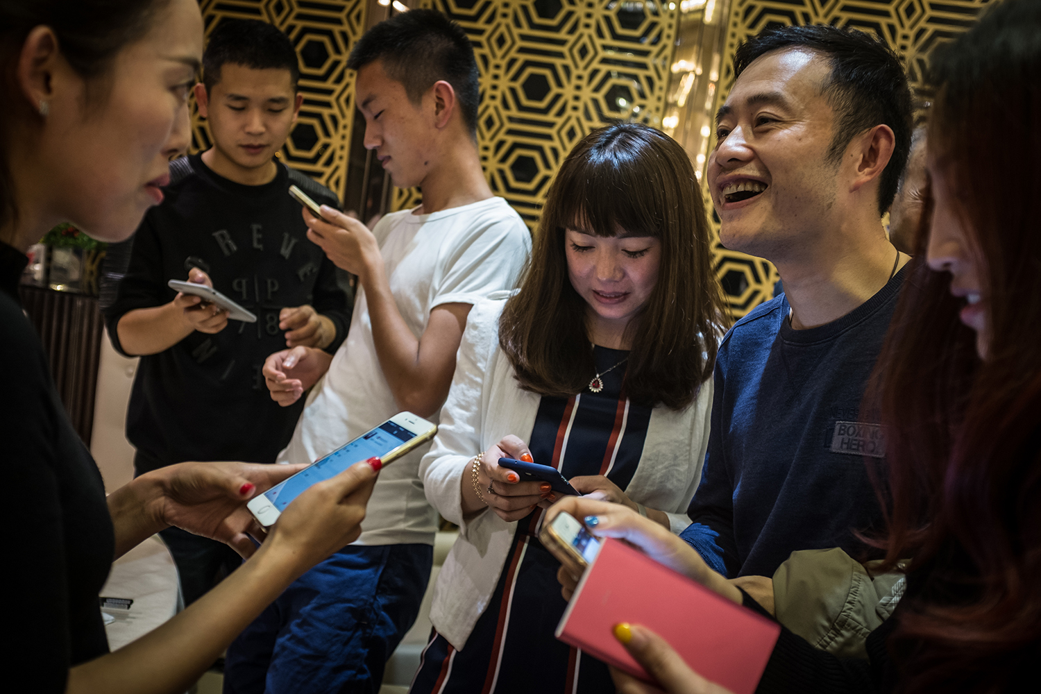 Bitcoin miners add each other on social media at the first China Bitcoin Miner Conference, at Chengdu Tianfu Financial Center, in Sichuan province, October 22, 2016.