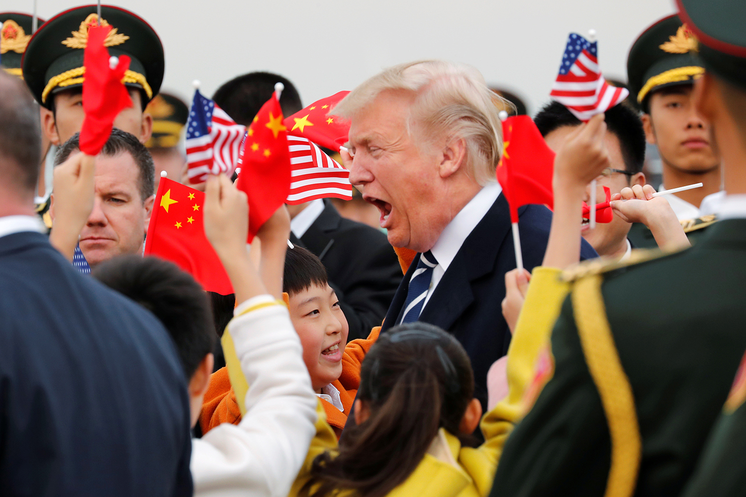 November 8, U.S. President Donald Trump and First Lady Melania arrive on Air Force One in Beijing. Despite his frequent harsh rhetoric about China, Trump seemed to bask in the pageantry of his November state visit. (Jonathan Ernst/Reuters)