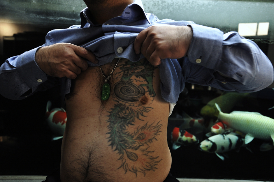 "Sun Yee On, a retired ""red pole"" enforcer for the organized crime triad, parted ways with the triad peacefully several years ago, but still has the phoenix-tailed dragon tattoo hidden under his shirt. ""Back in the old days,"" he says, ""it was all about heart—about righteousness and virtue. Now it is more of a business for profit."" Criminal gang activity, though still present in Hong Kong, is decreasing as triads pursue more lucrative activities of varying degrees of legality across the border in China."
