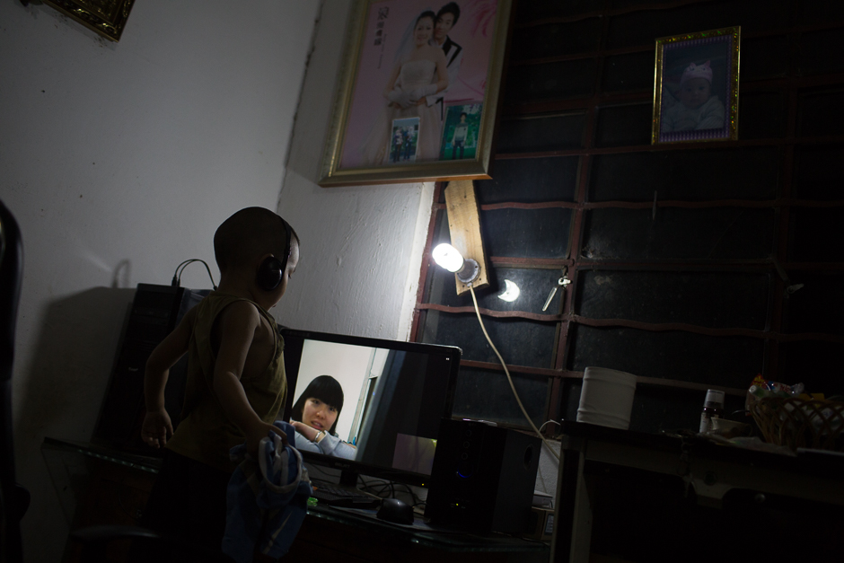 Four-year-old Le video chats from his home in Yunnan province with his mother, a migrant worker living in Zhejiang province. Le lived with his uncle and aunt in Xiaxinzhai village, Zhemi county. For most of his life, Le has lived apart from his 20-year-old parents, since they left to find work in 2012.