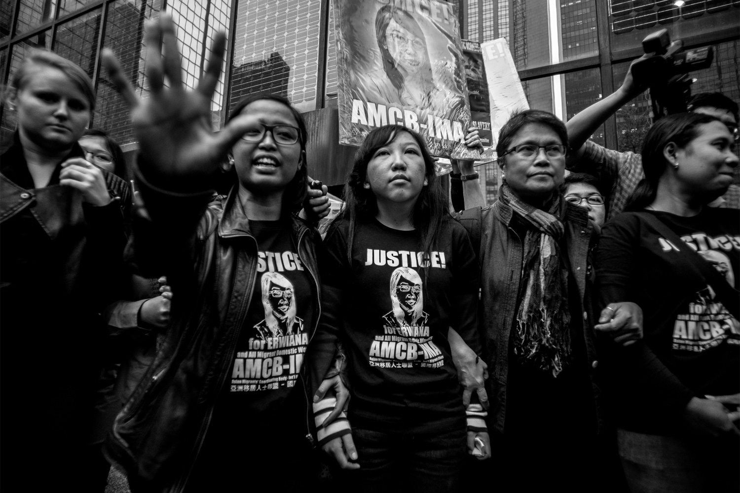 Erwiana Sulistyaningsih, center, leaves the sentencing hearing for Law Wan-tung in Wan Chai, Hong Kong, February 27, 2015. In a lawsuit that received international attention, a judge sentenced Sulistyaningsih's former employer, Law, to a six-year prison term on eight charges of assault. Found guilty of 18 out of 20 charges, Law was also fined H.K.$15,000, or U.S.$1,930, for failing to pay wages or grant her days off. Law physically, mentally, and psychologically abused Sulistyaningsih for months. She was beaten, underfed, and didn't receive wages, and her health deteriorated so much so that she was eventually unable to walk. Her employer threatened to hurt her family in Indonesia if she told anyone about the abuse and took her to the airport to send her back to Indonesia. There, another Indonesian traveler noticed her and helped her.