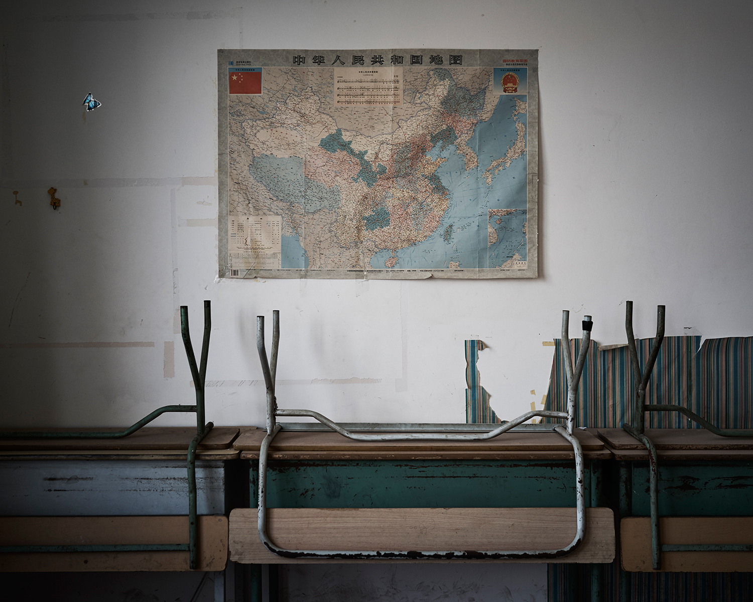 A map of the People's Republic of China hangs on the wall of an abandoned classroom in Nanguan Mosque's Arabic school, June, 2016.