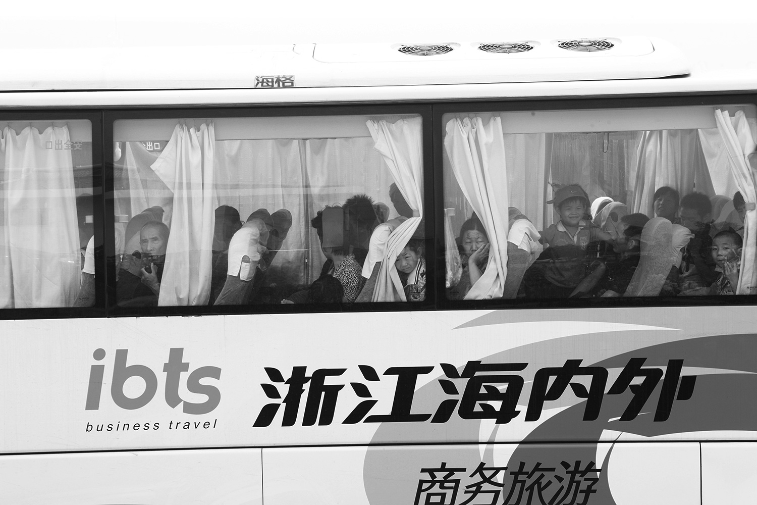 Some of the farmers board a bus to leave their homes and the village of Jinhe.