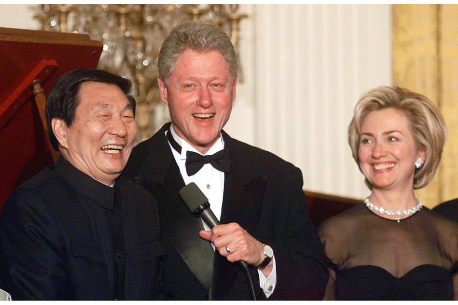 Chinese Prime Minister Zhu Rongji and U.S. President Bill Clinton make remarks during a state dinner with First Lady Hillary Clinton, April 8, 1999, at the White House. A major goal of Zhu's trip was to discuss the terms of China's entry into the World Trade Organization, which happened in 2001. (Photo by Joyce Naltchayan/AFP/Getty Images)