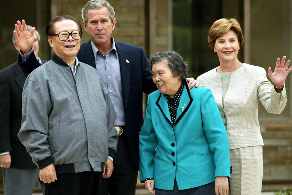 China's President Jiang Zemin and his wife, Wang Yeping, join U.S. President George W. Bush and First Lady Laura Bush in addressing the media at Bush's Prairie Chapel Ranch October 25, 2002 in Crawford, Texas. Jiang toured the Bush family ranch by truck and dined on Texas barbecue. (Photo by Stephen Jaffe/AFP/Getty Images)