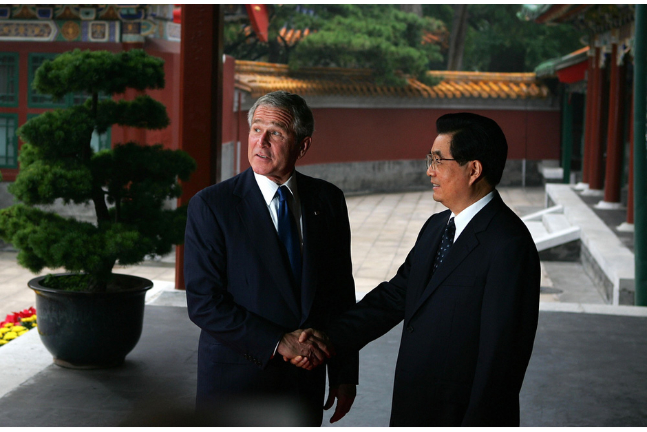 U.S. President George W. Bush is greeted by Chinese President Hu Jintao at the Zhongnanhai leadership compound in Beijing on August 10, 2008. On the same visit, President Bush attended a church service and urged China's leaders not to be afraid of religious freedom. (Photo by Guang Niu/Pool/AFP/Getty Images)