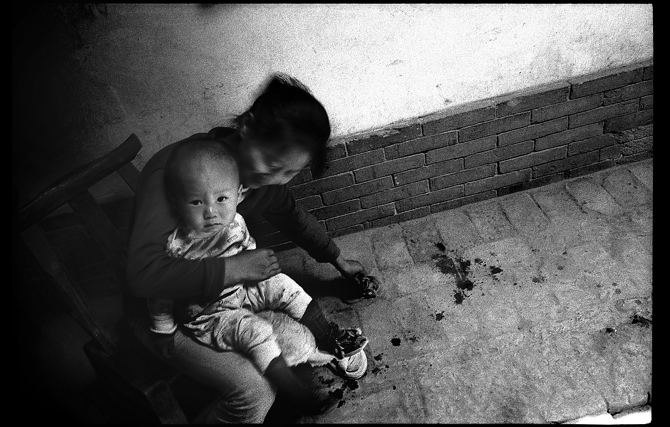 Xiao Shan gets her one year old son, Cha Li, ready for his final hepatitis B vaccination. While a safe and effective vaccine to prevent hepatitis B has existed for over twenty years, few people actually receive all three injections required to provide immunity. Shaanxi, China