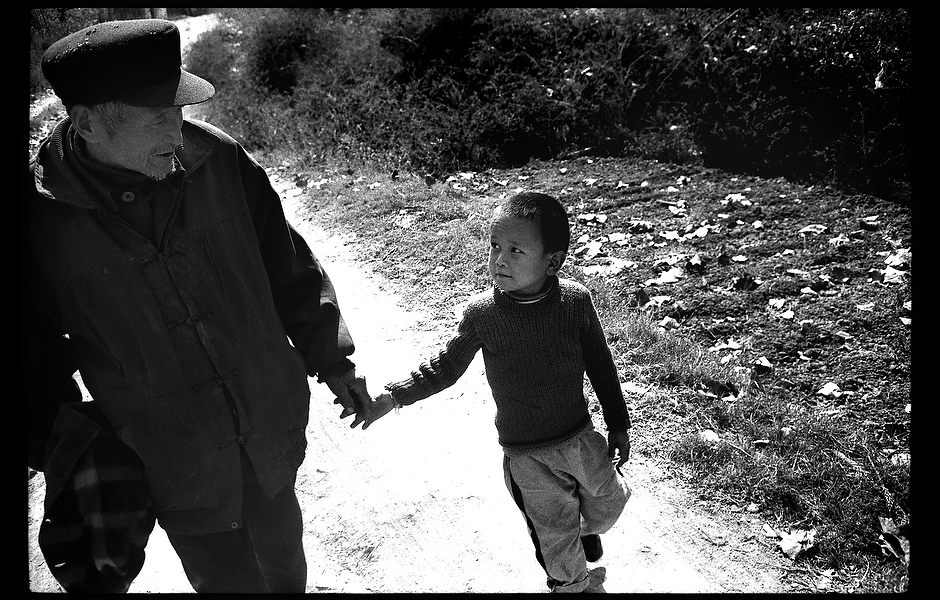 Since his father's death, Xiao Wang has been taken to school by his grandfather. Like AIDS, hepatitis B is spread from mother to child, infected needles, and unprotected sex. Unlike AIDS, a safe and effective vaccine exists, but inadequate education and a social veil of silence have resulted in the infection of as many as 400 million people worldwide. Henan, China